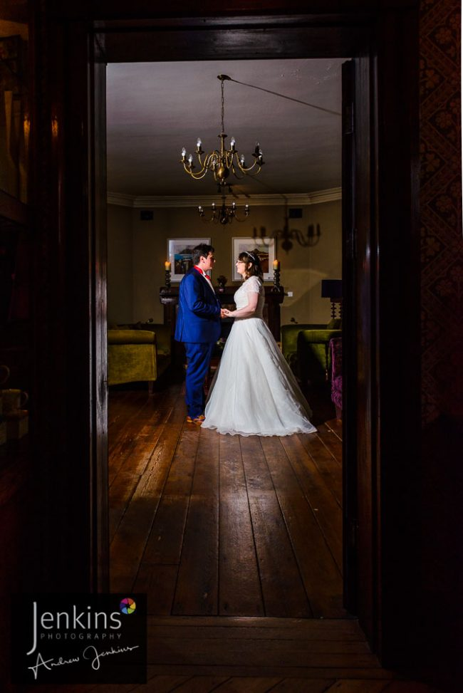 bride & Groom portait taken through open door way